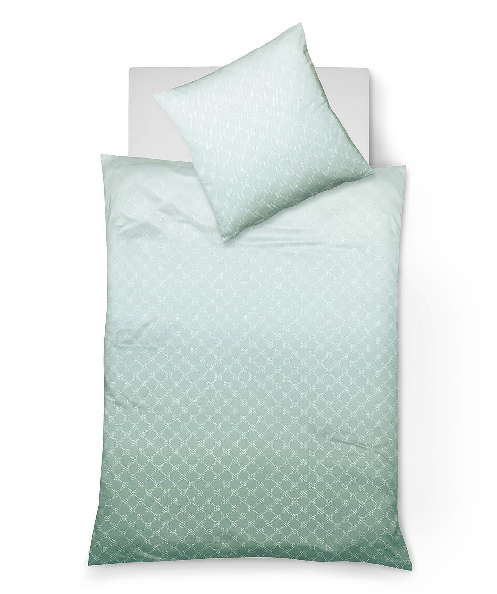 Bettwäsche mit grafischem Muster und Farbverlauf in Grün